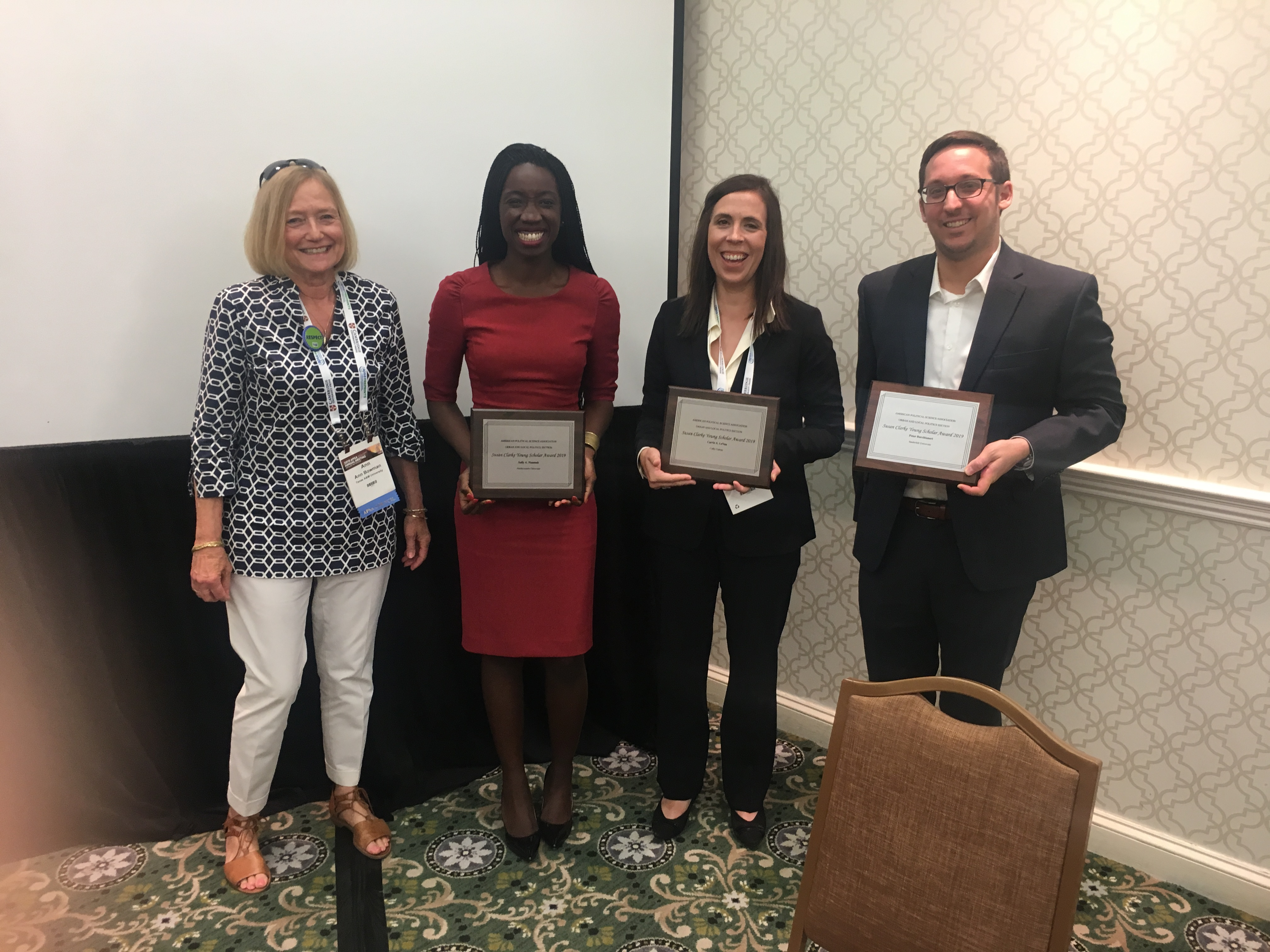 Ann Bowman presents the Susan Clarke Young Scholar Award to Peter Bucchianeri, Carrie A. LeVan, and Sally A. Nuamah