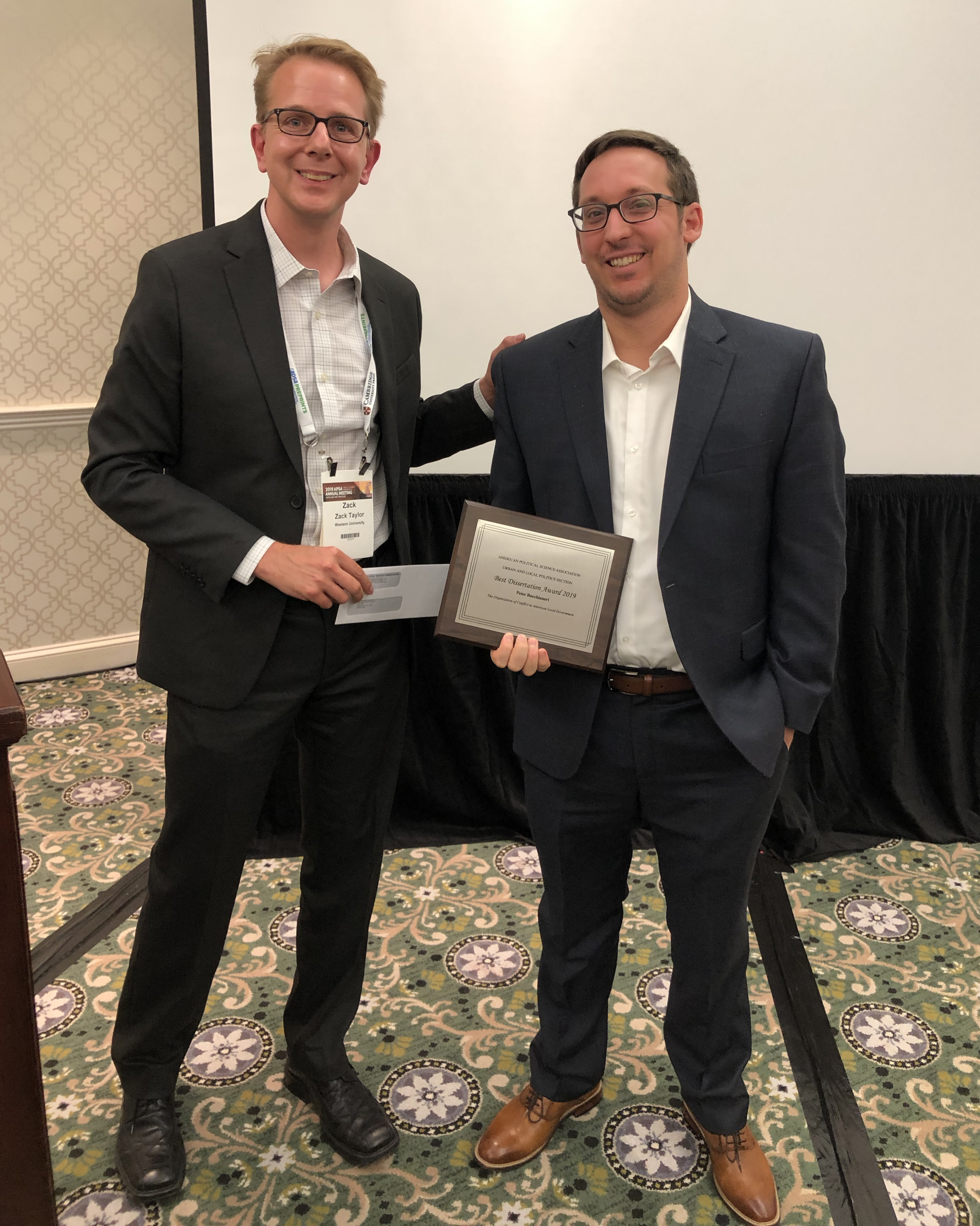 Zack Taylor presents the Best Dissertation Award to Peter Bucchanieri at the 2019 APSA conference.