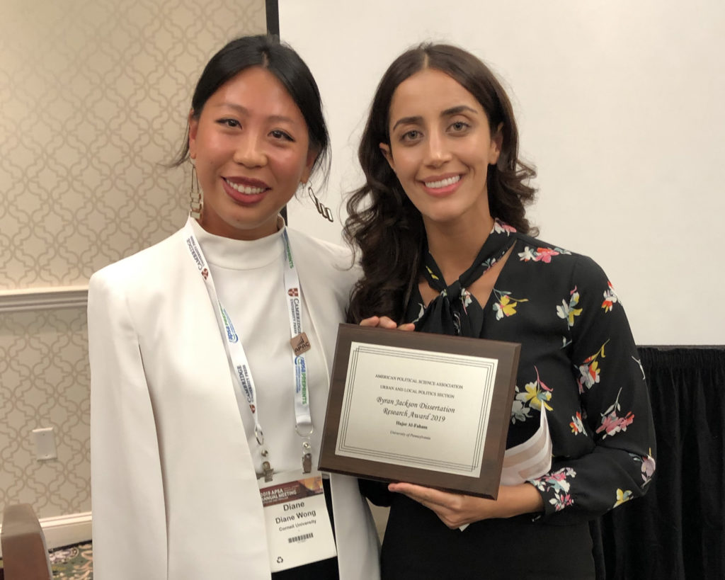 Diane Wong presents the Byran Jackson Dissertation Research Award to Hajer Al-Faham at the 2019 APSA conference.
